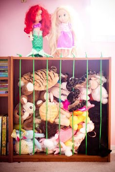DIY stuffed animal zoo storage using bookshelf and bungee cords