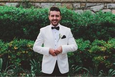 groom white suit