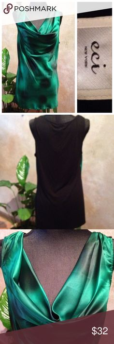 NWT Green Drape Neck Tank Front is a beautiful green with dark green splotches (photo makes them look much darker than they really are).  Back is all black and slightly stretchy. ECI Tops Tank Tops