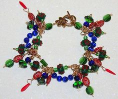 MCFROGGY'S ORIGINAL ONE-OF-A-KIND HANDCRAFTED BRACELET-WIRE WRAP-CZECH-LAMPWORK-PRESSED GLASS-GREEN-RED-BLUE-INCLUDES A FREE GIFT-CERTIFICATE OF AUTHENTICITY & GIFT BAG-$24.99-FREE SHIPPING | eBay