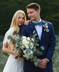 modest wedding dress with flutter sleeves and a flowing lace skirt from alta moda (modest bridal gown)
