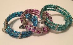 Spring 2013 Collection: Beaded Butterfly Cuff Bracelet made from memory wire with silver floral connectors, an assortment of glass beads and a large silver butterfly bead.  This bracelet is available in teal, purple and blue for $19.99.