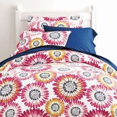 Fun floral kids sheets & bedding set feature bright starburst daisies. Adds a brilliant pop of color and pattern to the bed!