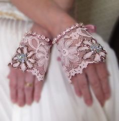 I LOVE these lacy cuffs! No problem to get the ring on, and they're so classy, and very DIYable. there's other nice ones here too click to link to OBB.