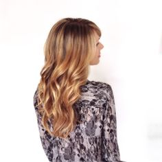 Long healthy hair. Soft golden blonde foils with a slightly darker root. Romantic curls.