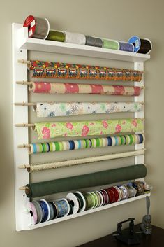 DIY Paper and Ribbon holder. Turtles and Tails: Paper Centre Facelift. Perfect for Craft Room or Holiday Wrapping. Sewing Room Storage, Craft Room Storage, Sewing Rooms, Wall Storage, Craft Organization, Diy Storage, Storage Ideas, Wrapping Paper Organization, Craft Rooms