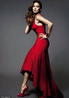 Jennifer Lopez shows off her shape in a waterfall scarlet dress and matching top as she poses in Vogue magazine