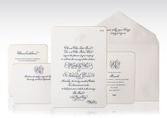 Classic and timeless engraved wedding invitation with monogram and gold foil edges