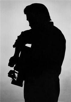 Order a 1970 Johnny Cash print today from Morrison Hotel Gallery. This authentic Johnny Cash silhouette photo was taken by Al Clayton in Nashville, TN. Old Country Music, Outlaw Country, Country Music Singers, Young Johnny Cash, Johnny And June, Morrison Hotel, Ken Burns, Matchbox Twenty, Paul Mccartney