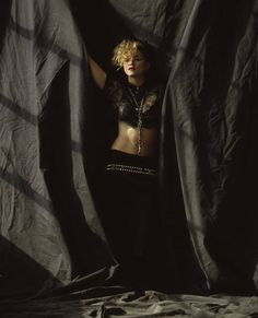 Madonna 1985 by Herb Ritts. This photo, 24x36 BW print hangs on my Bedroom Wall, a gift from my Aunt Joyce