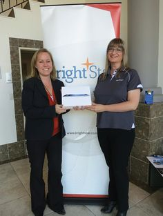 Megan Paul from Aurecon NZ won our AAPNZ prize draw in May 2012 - here with Lone, Bright*Star Training Director, and her new 32G IPAD!