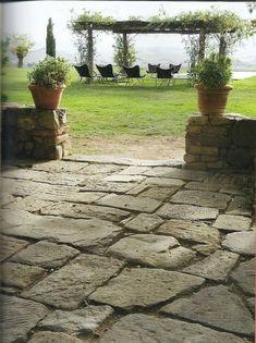 Rustic Italian stone patio, planters and vine covered arbor