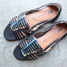 Strappy huarache sandals from BC Footwear with vegan leather straps woven through colorful geo print uppers. Features a durable rubber heel for traction.Content