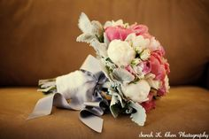 peonies and mini roses wrapped up in a satin bow for the bridal bouquet