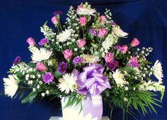 Custom Sympathy Basket featuring lavender roses, snapdragons, larkspur, and spider mums.