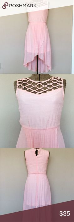 Lily Rose blush dress high low caged XS lined pink Excellent condition! Size XS. Bust: 16 High low length . Lined length:31 in Back length: 44 in. Elastic waist. Bust and back lined. Sheer chiffon overlay. Button at back neck. Caged detail at upper chest collar. Peachy pink. So feminine! 💕 No trades 🎁Happy poshing! TAGS # pale pink pastel summer sun dress swim vacation wedding rose 2017 Lilly mini midi sleeveless lined slimming sexy pretty western cowgirl career casual Lily Rose Dresses…