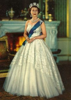 Queen Elizabeth II. She looks simply divine in this ensemble. One of my all-time favorite gowns owned by the Queen.