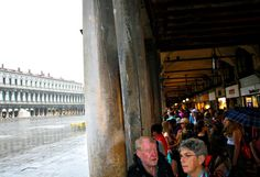 VENICE, ITALY- Waiting out the rain at St. Mark's Plaza