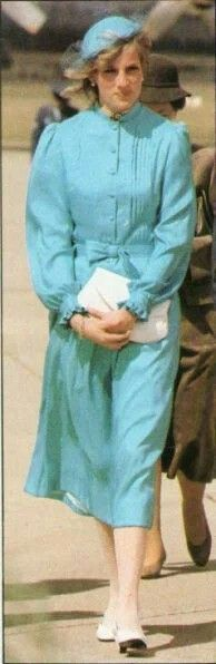 March 24, 1983: The Princess of Wales wears a bright turquoise silk two-piece suit by Catherine Walker when she arrived in Canberra, Australia on 24th March 1983. The blouse has tiny pin tucks on the bodice and a mandarin collar. The skirt is full. The small skull cap is by John Boyd. Image result for princess diana in australia 1983