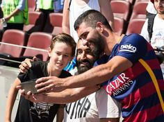 Arda Turan taking a picture with some fans during his presentation at the Camp Nou...