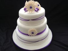 this is my 3rd time making a wedding cake.flowers are edible and handmade
