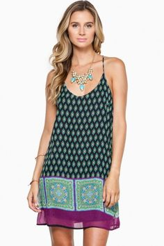 This sleeveless racerback dress is detailed with a flirty scarf print.