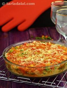 Just when you are enjoying a juicy raisin, a creamy cashew peeps in; and just as you are enjoying the soothing flavour of coconut milk, tangy tomato sauce pipes up! Indeed, the Baked Vegetables with Creamy Coconut and Tomato Sauce is an indescribable delight that has to be experienced. Bread slices topped with a coconut-milk based curry of myriad vegetables and a tangy tomato sauce too, are coated with oodles of cheese and baked till the ingredients melt into each other and fuse to create a…