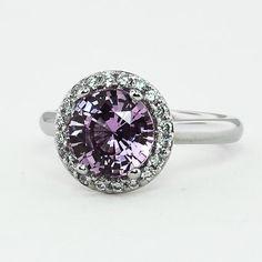 #brilliantearth    Modified Halo Diamond Ring set with 7.5mm Round Premium Pink Sri Lankan Sapphire