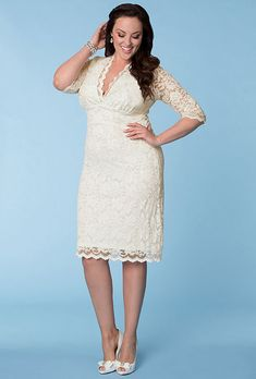 Brides.com: . Luxe lace wedding dress, $242, Kiyonna available at Sonsi