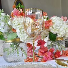 pink bougainvillea, white hydrangea and gold goblets