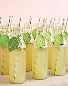 Welcome guests to your reception with refreshing drinks that are tagged with their table numbers. The chilled mint lemonade shown here is delicious for spring and summer occasions. In the cooler months, serve apple cider or hot cocoa in mugs.