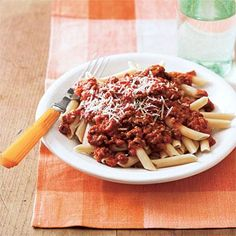 This rich slow-cooker sauce can be spooned over spaghetti, polenta or penne, and served with grated Parmesan on the side. Use leftover sauce to incorporate into a baked ziti or zesty stew.