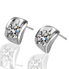 Lady's Brass Stud Earrings with Swarovski Elements Clear Stone Sitting on a Cushion