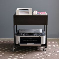 My printer is always in the way. I need one of these so i can move it around. This is by West Elm, Flat-Bar Printer Caddy                                                                                                                                                                                 Más