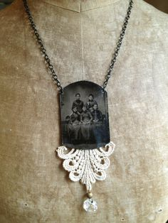 Sister Act - Altered Art Necklace. $39.95, via Etsy.