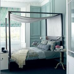 Glamorous metallic bedroom -- Four-poster bed: The White Company -   Bedside tables: Brissi - Wooden trunk:  Oka - Wall paint: Marston & Langinger -   Roman blind: Jane Churchill - Homes & Gardens