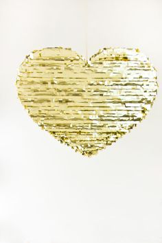 Creative: Eleven Cute Handmade Valentines  For your glittery Valentine > DIY Gold Mylar Heart Piñatas for Valentine's Day at Studio DIY