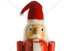 close-up shot of a figurine of santa clause nut cracker - Close-up shot of a figurine of Santa Claus in hat.