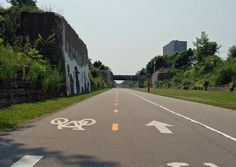 The Dequindre Cut Greenway, an urban recreational path, opened to the public in May of 2009. The 1.35-mile greenway offers a pedestrian link between the Riverfront, Eastern Market and many of the residential neighborhoods in between. Formerly a Grand Trunk Railroad line, the Dequindre Cut is a below-street level path that runs parallel to St. Aubin Street, between Mack Avenue and Woodbridge Street just north of the Riverfront.