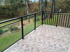 This is a very impressive deck. I like the material used on the surface of the deck. It has such good contrast with the black railing. I also like the way the railing is a combination of traditional rods and glass.