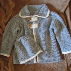 This toddler car coat PATTERN is a wonderful project for an intermediate knitter.  Knit in garter stitch from sleeve to sleeve, it comes in two lengths. #toddlerknittingpatterns