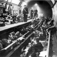 Londoners take shelter during a German bombing during the Blitz. This photo is…
