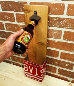 Crack open a tasty Michigan-made beverage with the Wall Mounted Bottle Opener. Includes vintage looking bottle opener and Michigan license plate to hold the bottle caps. All mounted on an unfinished board.