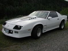 I bought a bright red brand new Chevy Camaro with t-tops in 1984.