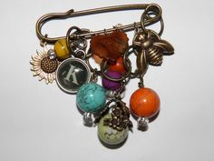 ....dismantel old charm bracelets and make pins.- think about a redesign of my 1960's charm bracelets