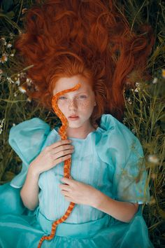 What you're about to see is not Photoshop – Moscow-based Russian photographer Katerina Plotnikova created these stunning images with the help of real live animals! / red head / girl / snake / grass