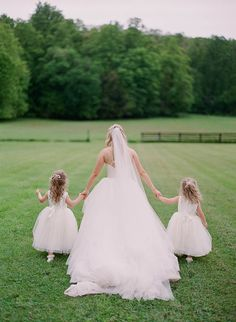 The bride and her flower girls. Photography : Studio Elle Photography Read More on SMP: http://www.stylemepretty.com/ohio-weddings/akron/2016/08/08/enchanting-blush-gold-wedding-in-the-ohio-countryside/