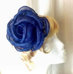 A personal favorite from my Etsy shop https://www.etsy.com/listing/227019840/large-sapphire-blue-sinamay-burlap