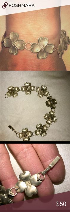 """Artfully done BRACELET O F STERLING CLEMATIS Beautifully lined up clematis flowers  fashioned in simple yet elegant sterling silver 925 throughout. Sturdy """"Bar Clip  Clasp"""". Silver Stars Collection Jewelry Bracelets"""