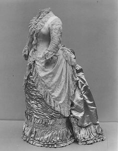 1880s from the MET. Love the ruched panel on the hem with the top made into pleats w/ braid, and the lower has tiny pleats.